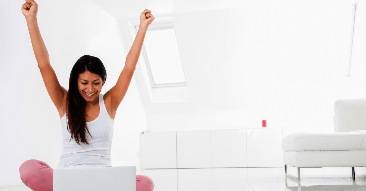 Woman excited she got her job application and can work from home